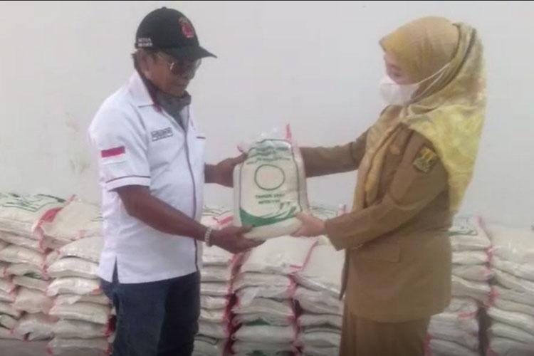 DPC PAMMI Sukabumi menerima bantuan beras dan uang tunai